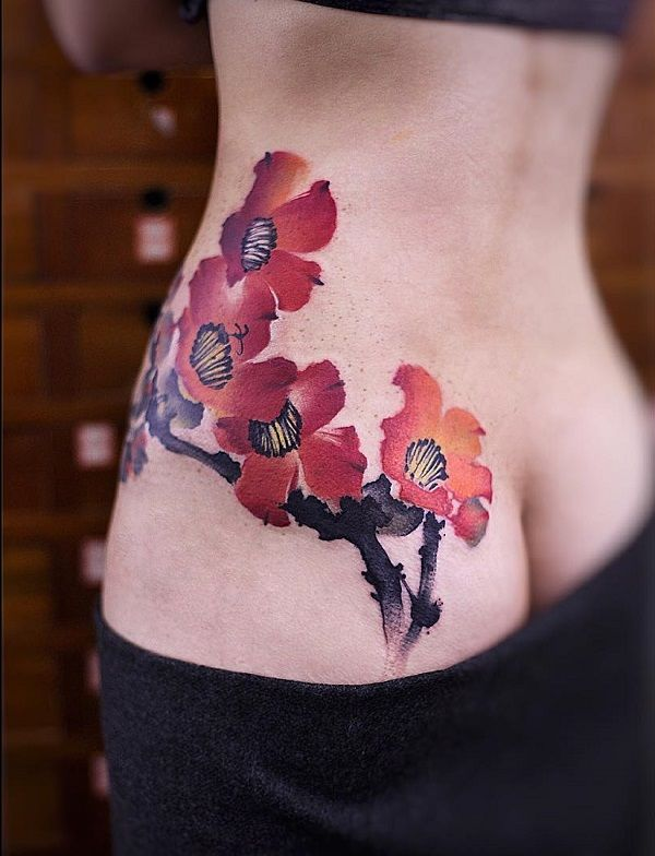 Flower side tattoo - 50 Rib Tattoos for Girls