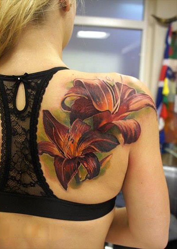 Realistic lily Tattoo on back by Andrey Grimmy - 55+ Awesome Lily Tattoo Designs