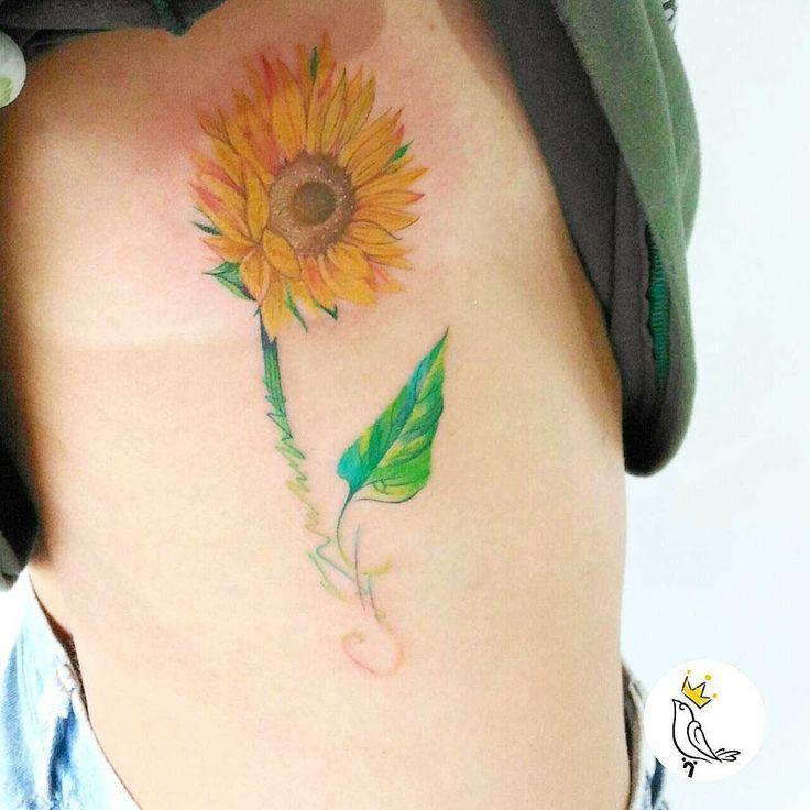sunflower tattoo on torso side