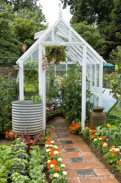 Love this greenhouse with lined path - pretty but functional veg growing
