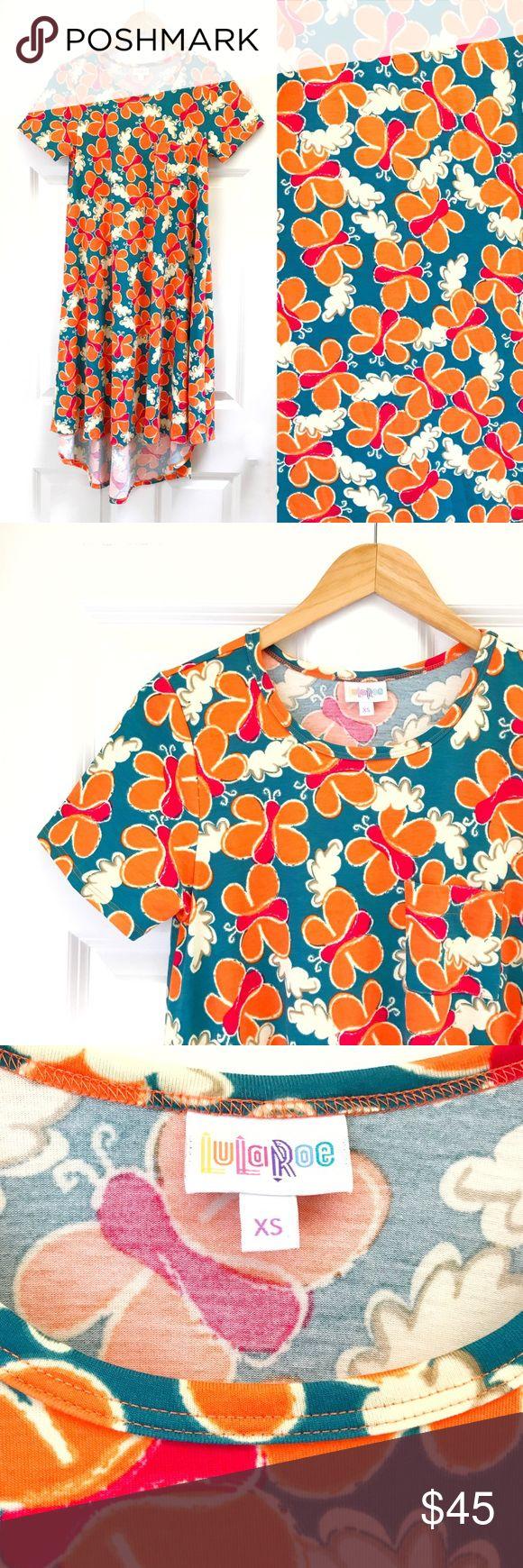 {LuLaRoe} XS Carly Dress LuLaRoe Carly Dress  The Carly is a swing dress that fl...
