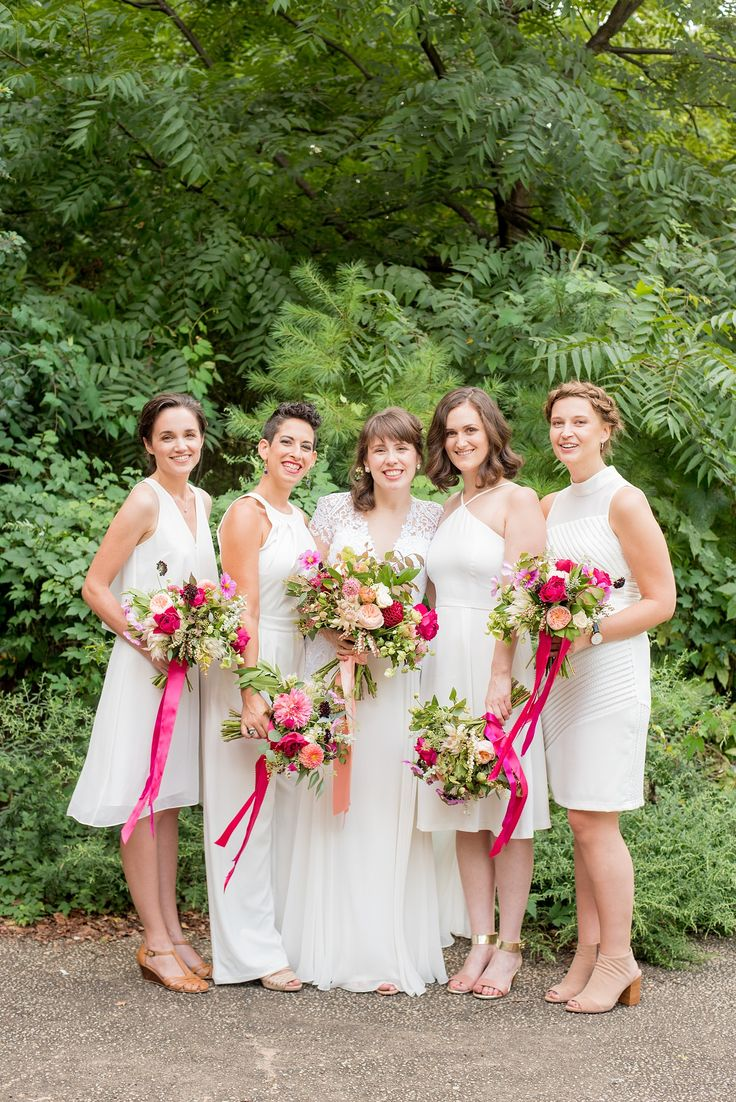 Mikkel Paige Photography photos of a bridal party in white with pink floral acce...
