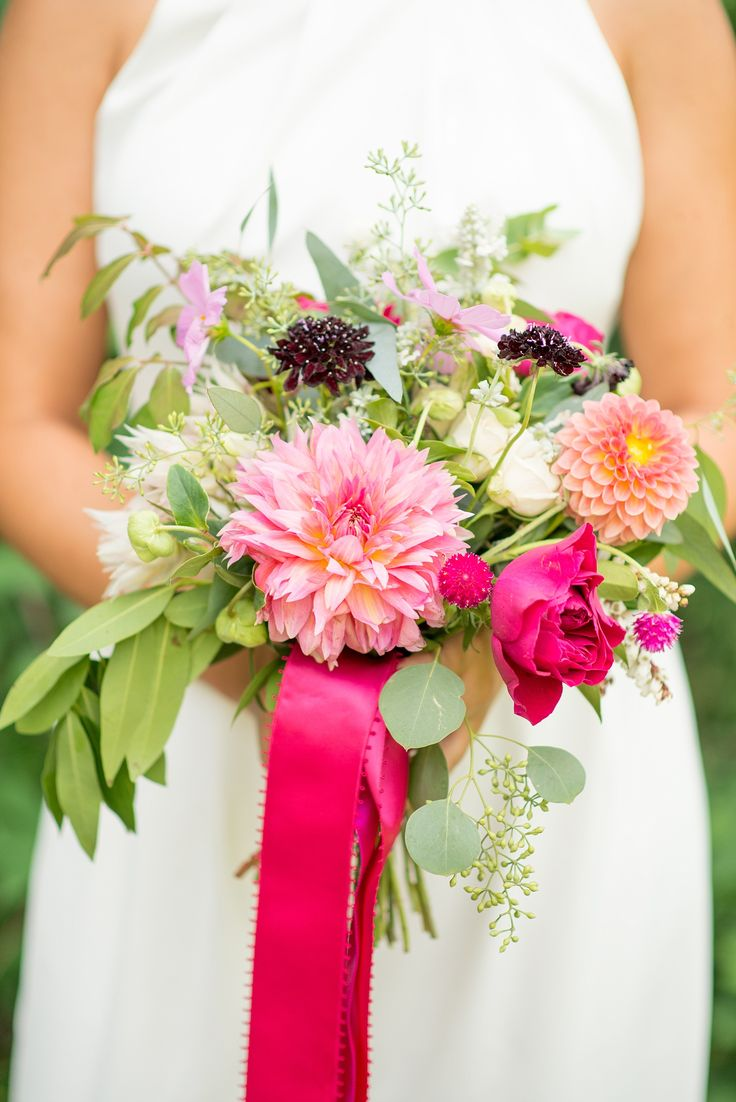Mikkel Paige Photography photos of a pink bouquet by Sachi Rose for a wedding at...