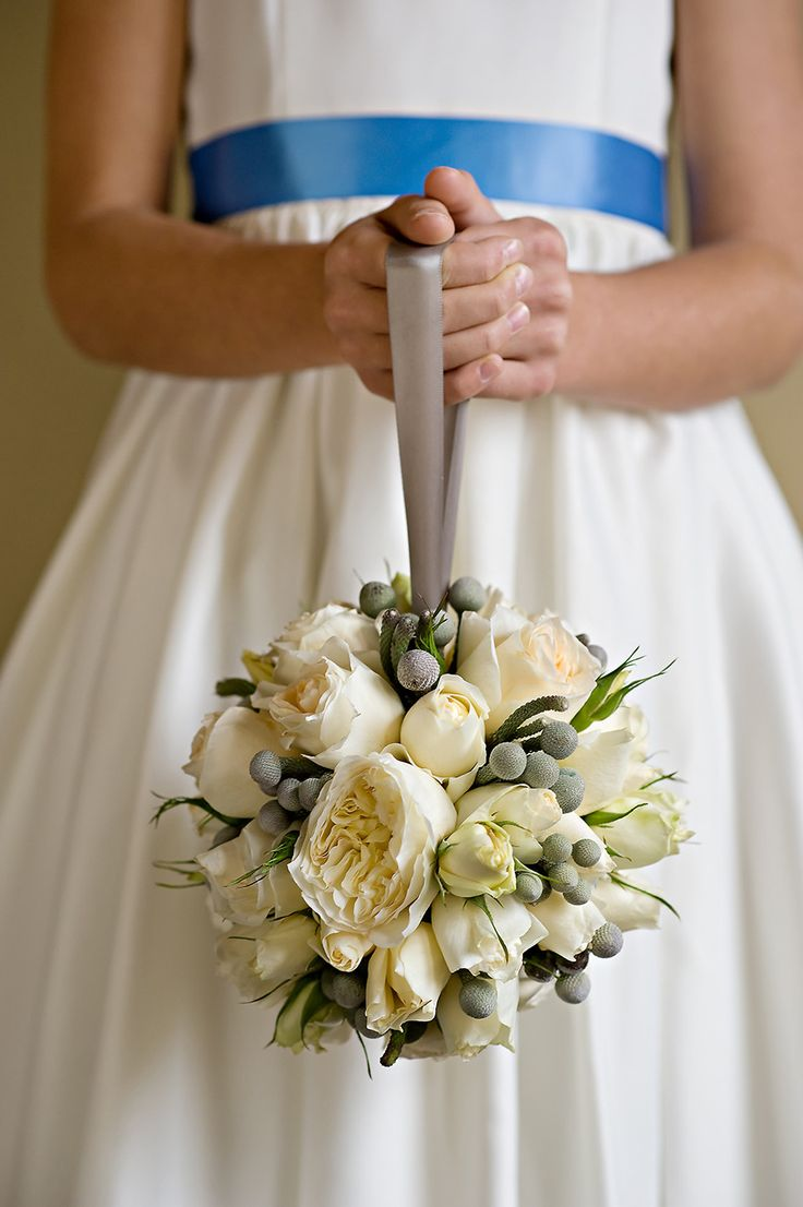 Flower Girl Pomander | See more of the wedding on #SMP: www.stylemepretty... Ora...