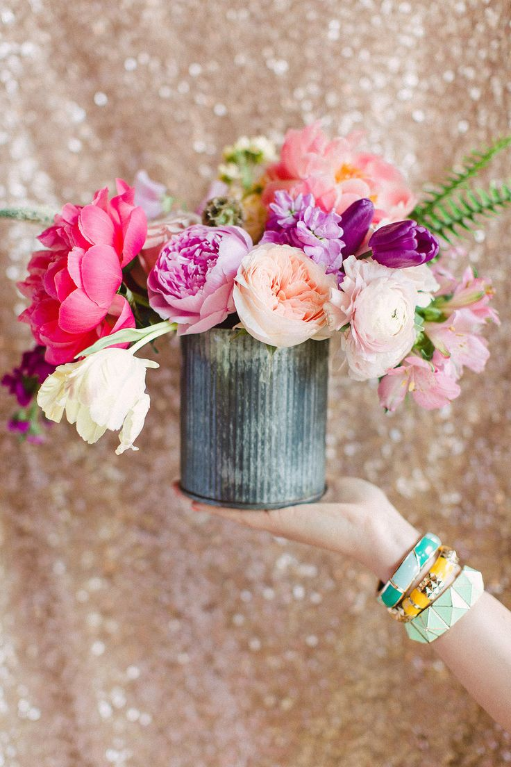 I love this vase. (We used some similar ones at our wedding). I have a feeling w...