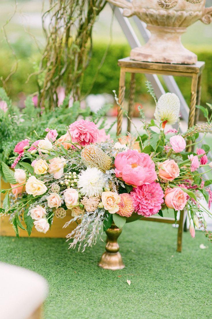 Pink and orange wedding Flower arrangements