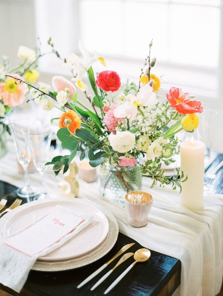 Spring tablescape with gold flatware