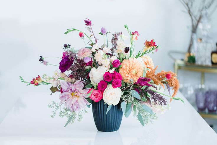 Wedding Flower Arrangement Ideas Photo by: Radion Photography Floral Design by: ...
