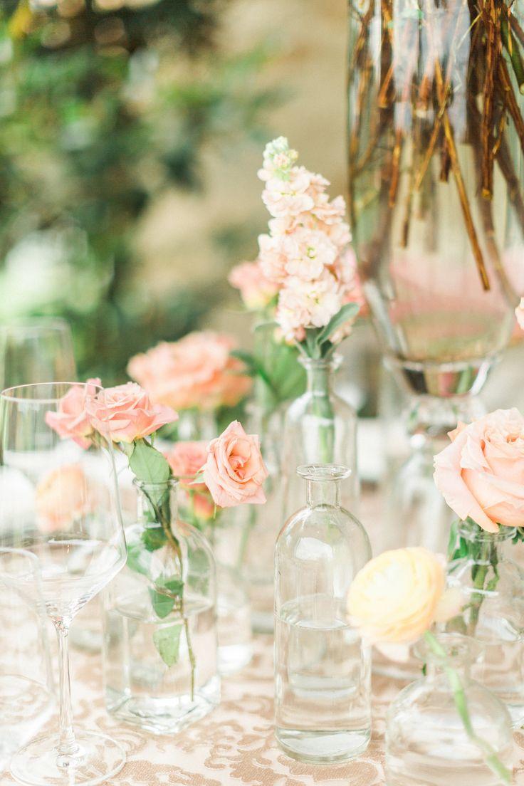 blush and pink bud vase centerpiece