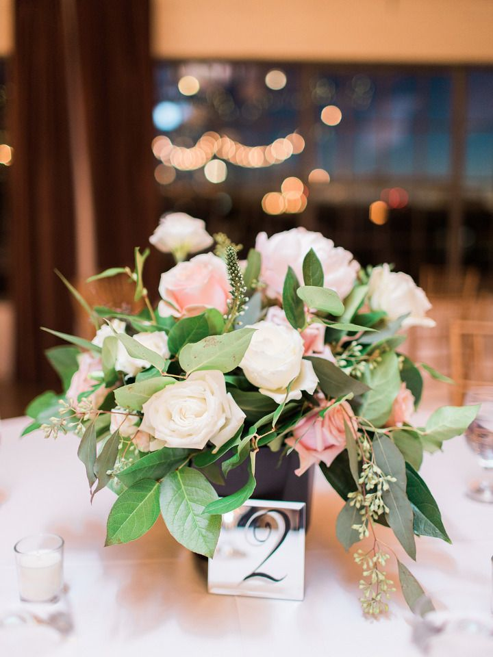 pink and white rose wedding centerpiece with mirror table numbers