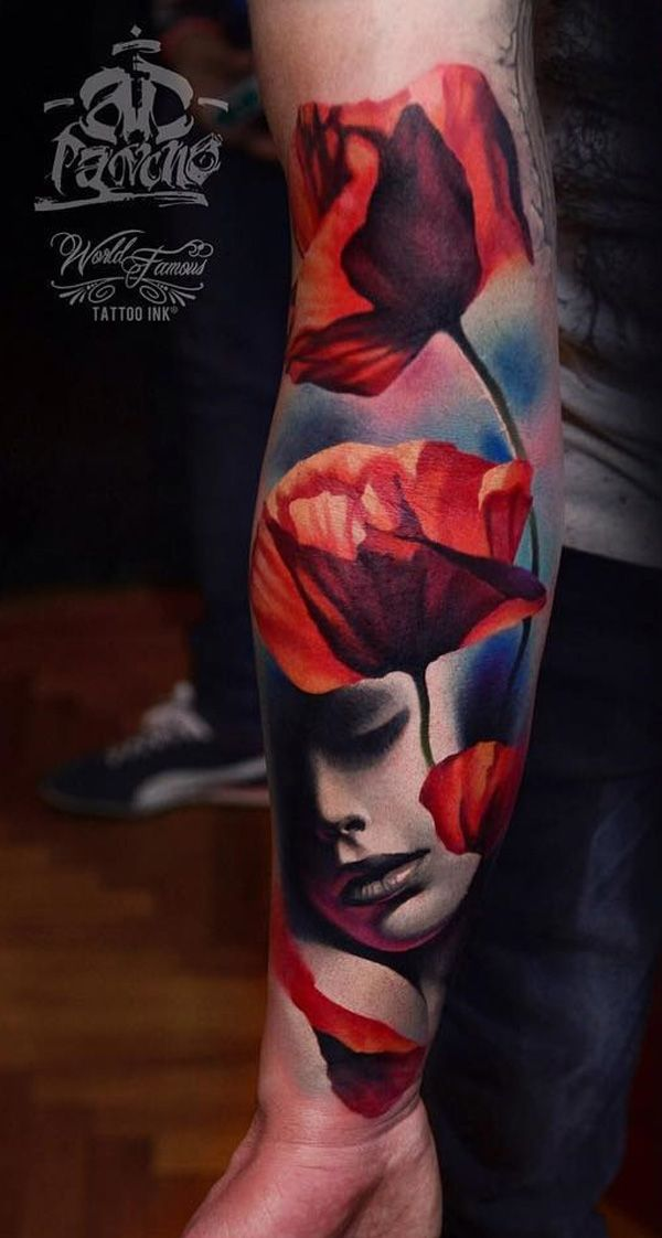 Beautiful looking sleeve tattoo. The design shows a group of red flowers facing ...