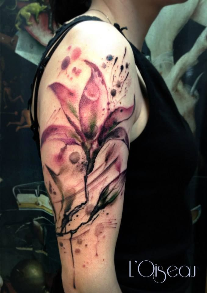 watercolor lily tattoo on sleeve by L'oiseau - 55+ Awesome Lily Tattoo Desig...