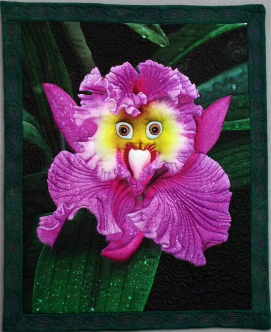 A Whimsical orchid flower with a parrots eyes is the subject of an art quilt by ...