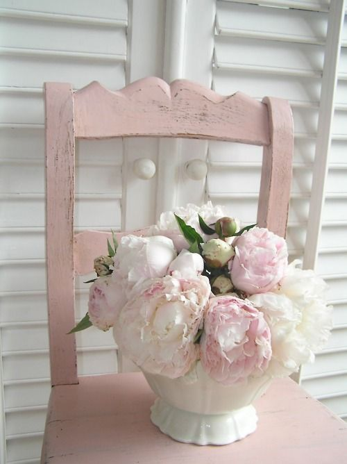 pale pink flowers and chair