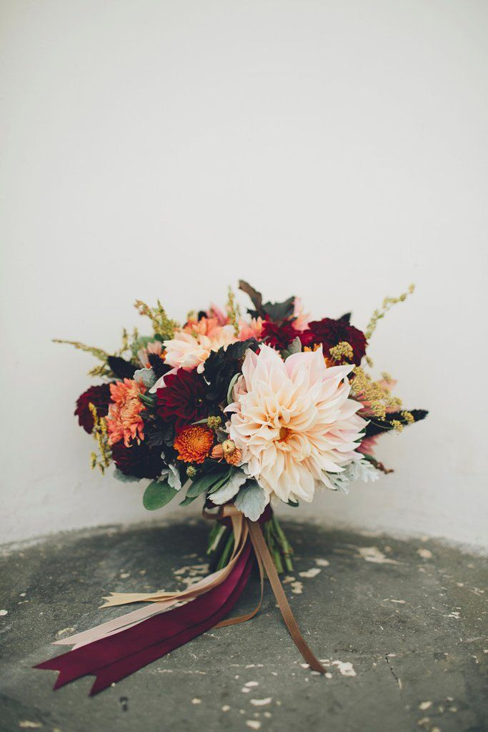 Bouquet of dahlias, chrysanthemums, and dusty miller by the Seasonal Bouquet Pro...