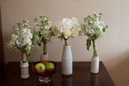 White bouquets made with flowers from Covent Garden Market in London. (Lauren Mc...