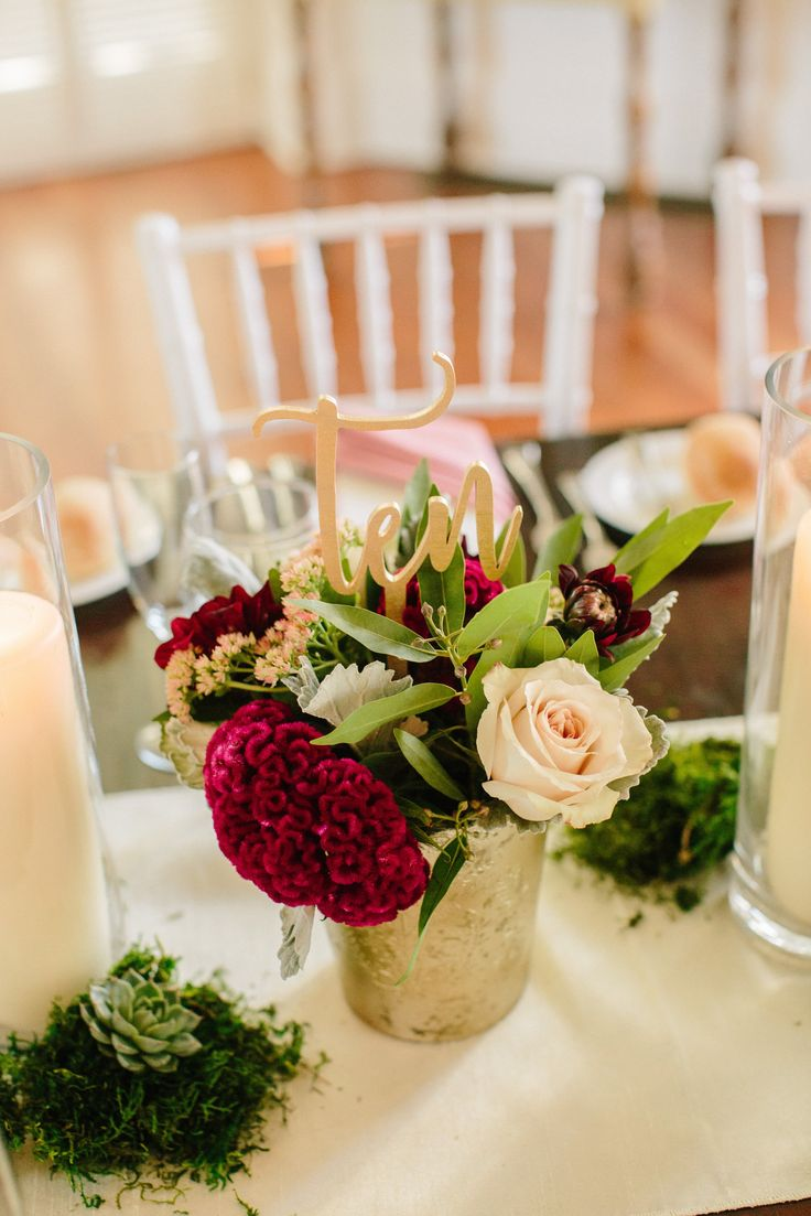 red and pink centerpiece with gold vase