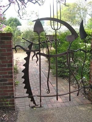 A garden tool gate--a neat idea but looks a little ominous. This would be good f...