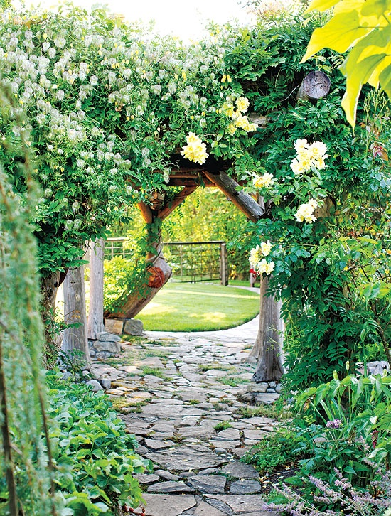 Enticing entry.... flagstone garden path under an arch way and into a beautiful ...