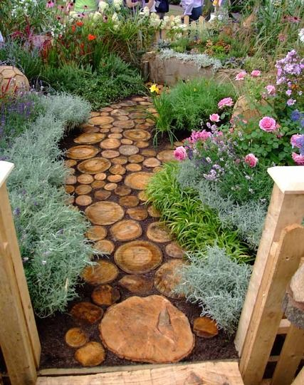 Reuse an old tree to make a log pathway in your garden!