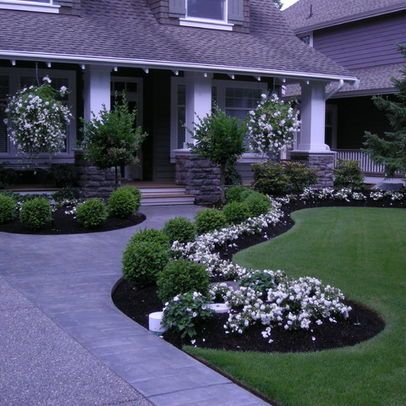 houzz.com- i love the extra width on the driveway and the curved walk to the fro...
