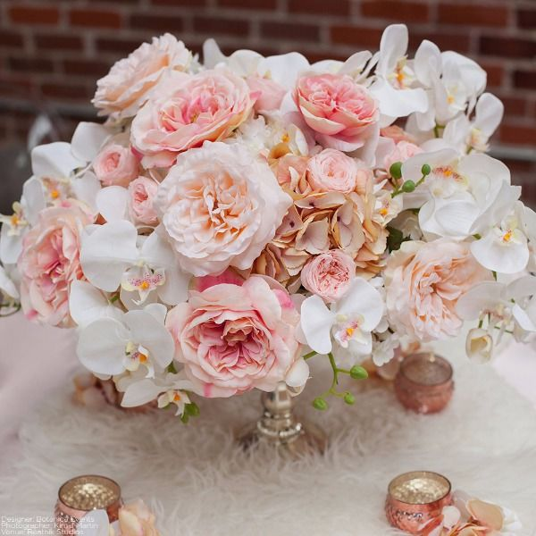 beautiful pink wedding centerpiece made of faux flowers