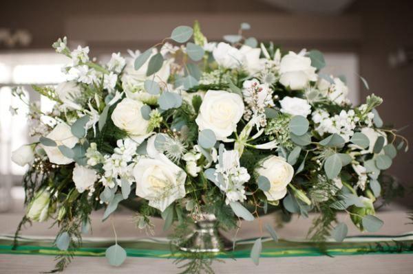 beautiful white rose wedding centerpiece