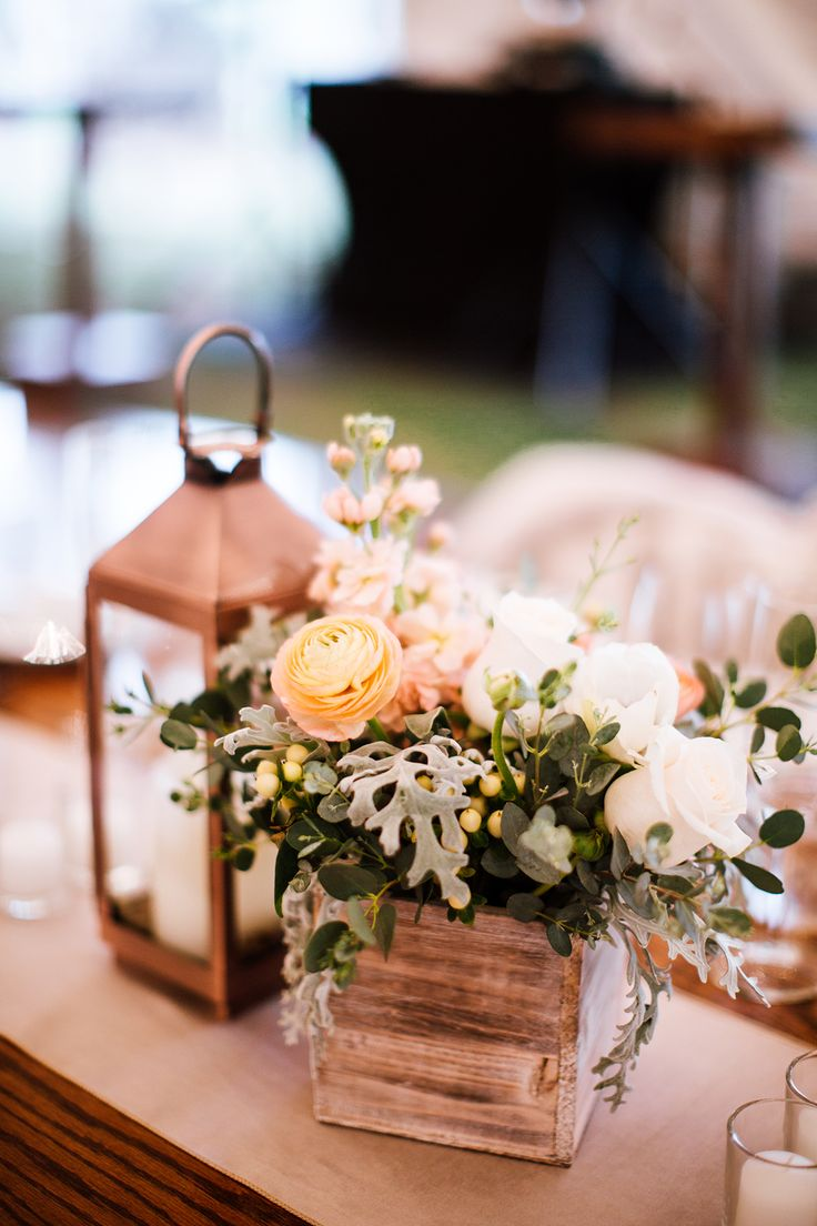 copper lantern and peach flower box centerpiece