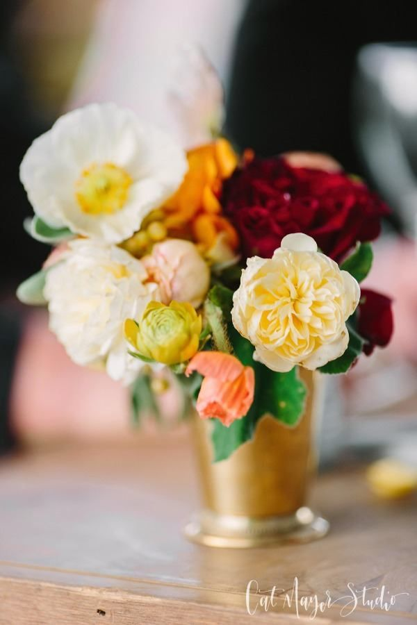yellow and red and gold wedding centerpiece
