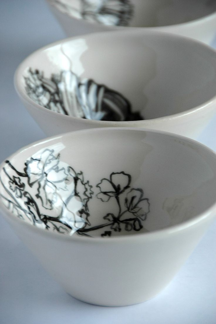 The inside of the bowls is an excuse to draw sketches of flowers that glide like...