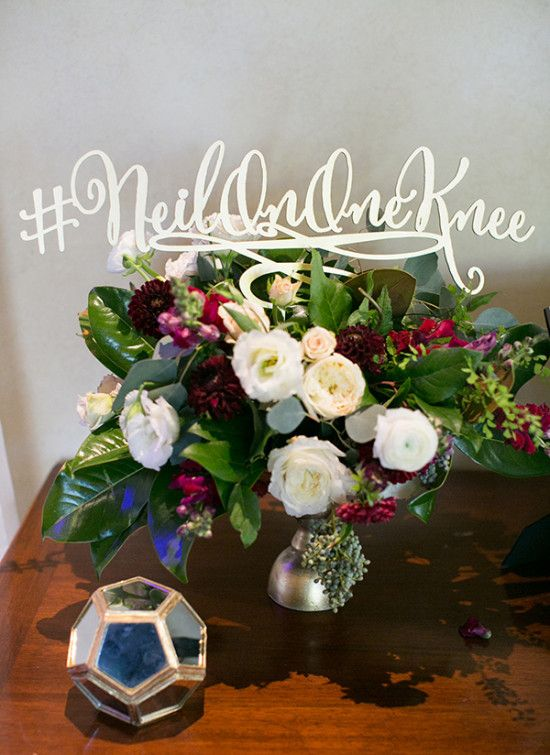 custom wedding hashtag and red white and peach centerpiece