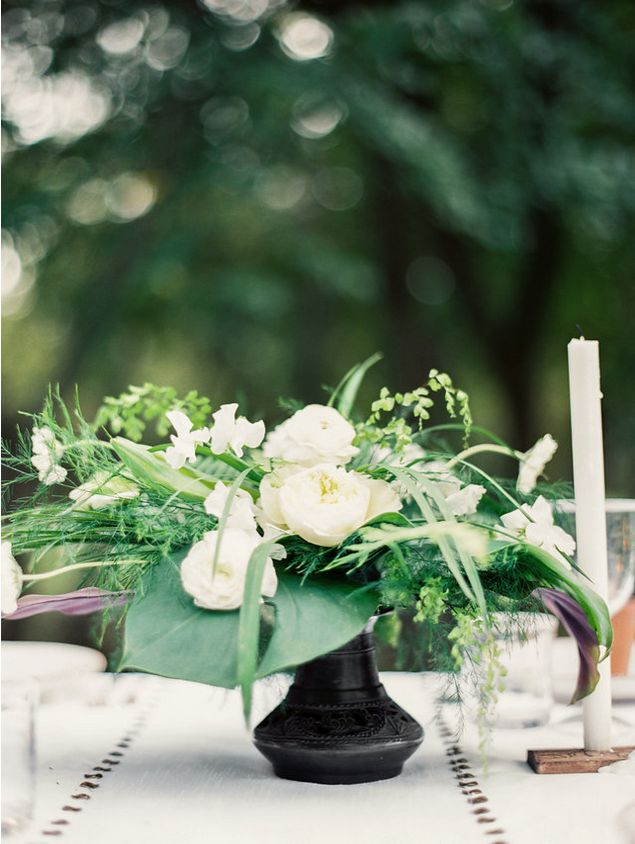 Green and white simple wedding centerpiece.