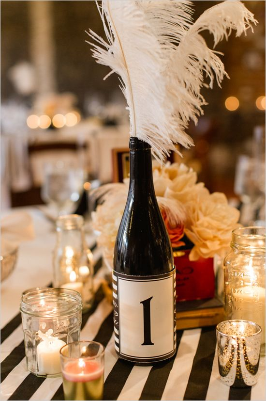 wine bottles with custom labels as table numbers #artdecowedding #corkplacecards...