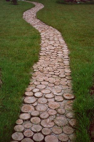 A garden walkway built from untreated tree trunk rounds won't be permanent, ...
