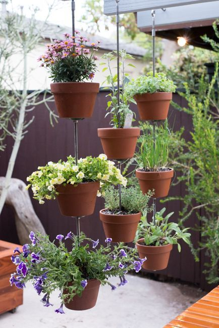 Vertical Garden Ideas: Hanging Clay Pots for Your Plants
