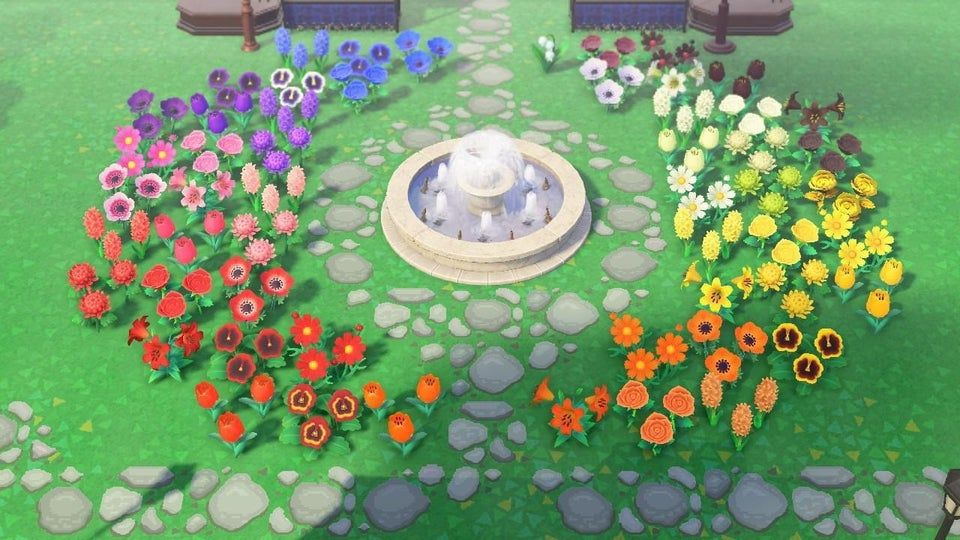 I made a rainbow garden outside my museum using one of every flower!
