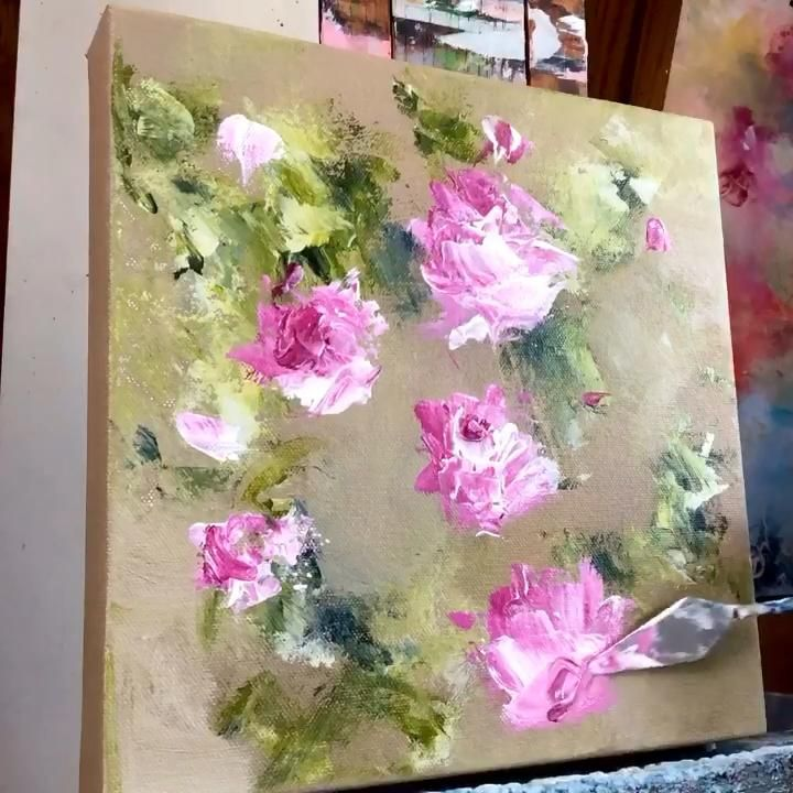 Adding the flowers with a palette knife on canvas
